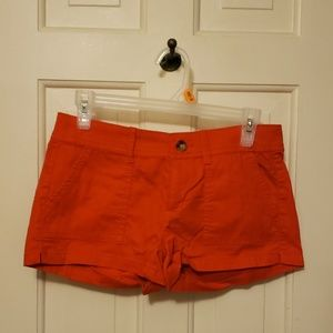 Bright red/orange shorts